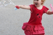 Paige Currie, 4, of Grand Forks enjoyed chasing bubbles while celebrating Canada Day in Christina Lake. Photo Erin Perkins.